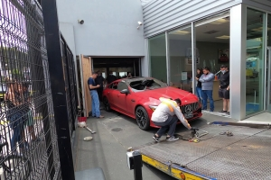 Clean-up begins at the Mercedes-Benz dealership in Oakland, CA, on June 3rd after George Floyld protests on June 2nd